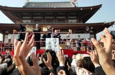 Beans are thrown during a traditional setsubun ceremony to dispel demons at Zojoji temple in Tokyo