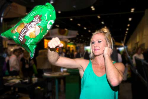 Can't bruise this! MMA fighter Holly Holm attempts to bruise the White Russet™ reduced bruising potato at the 2016 PMA Fresh Summit in Orlando, FL at Potandon's Booth Photo credit: Alex Menendez, Associated Press Images.
