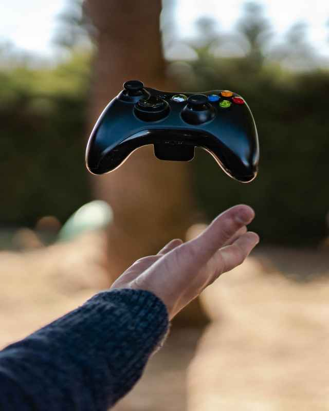 photo of person catching gamepad