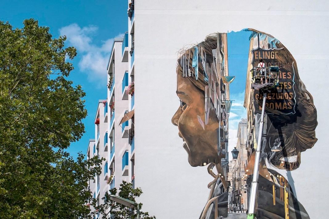 Artist Painting Mural in Berlin