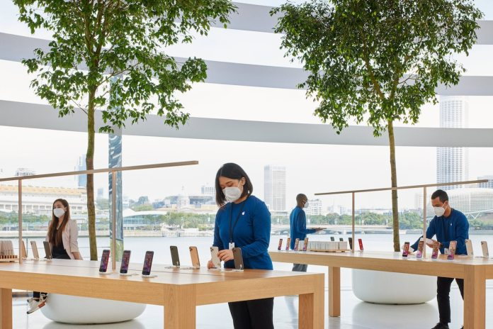 Woman Browsing Items at the Apple Singapore Store