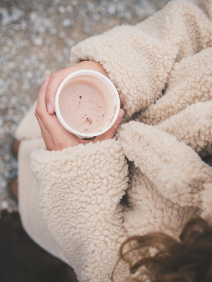 girl holding hot chocolate in hand