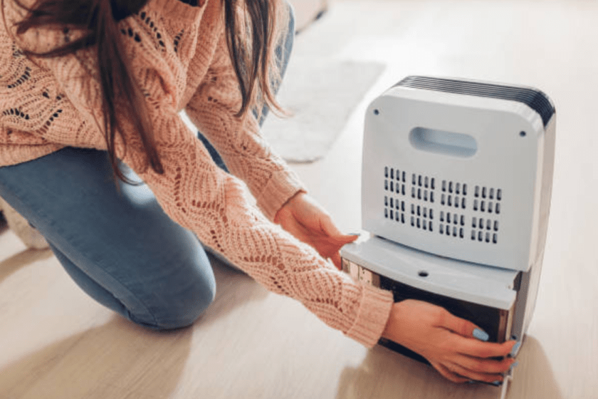 happy woman changing a humidifier at home