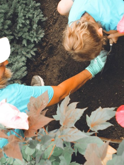 mom and child gardening together