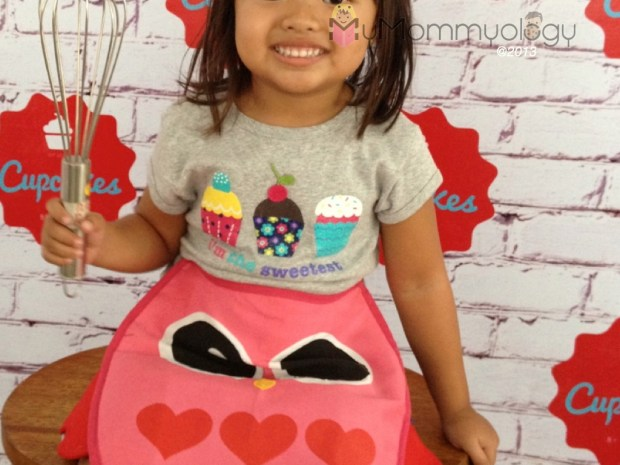 She wore her cupcake shirt specially for today. :) (incidentally - LOVE the new Cupcakes logo!)
