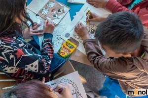 Children creating paper bag puppets for arts and crafts