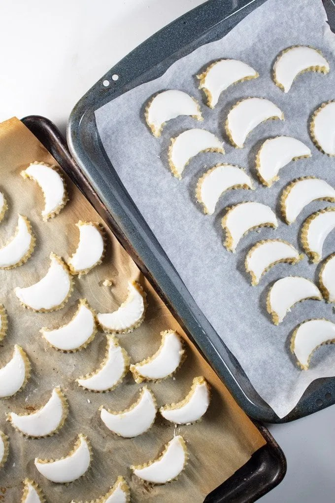 Crescent cookies cut and resting in baking sheet