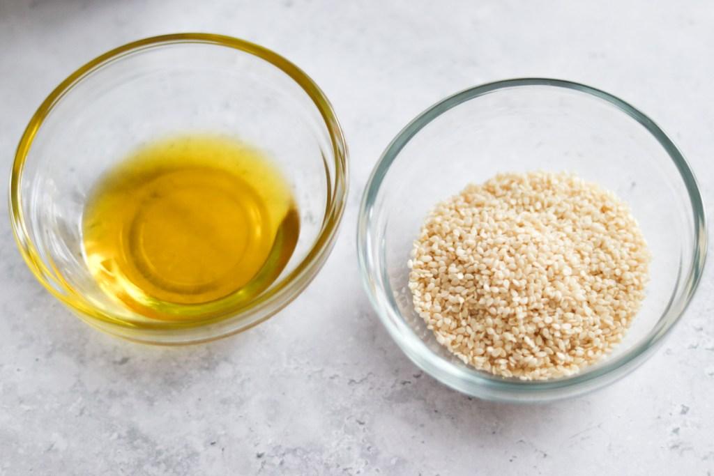 Tahini recipe ingredients - olive oil and sesame seeds.