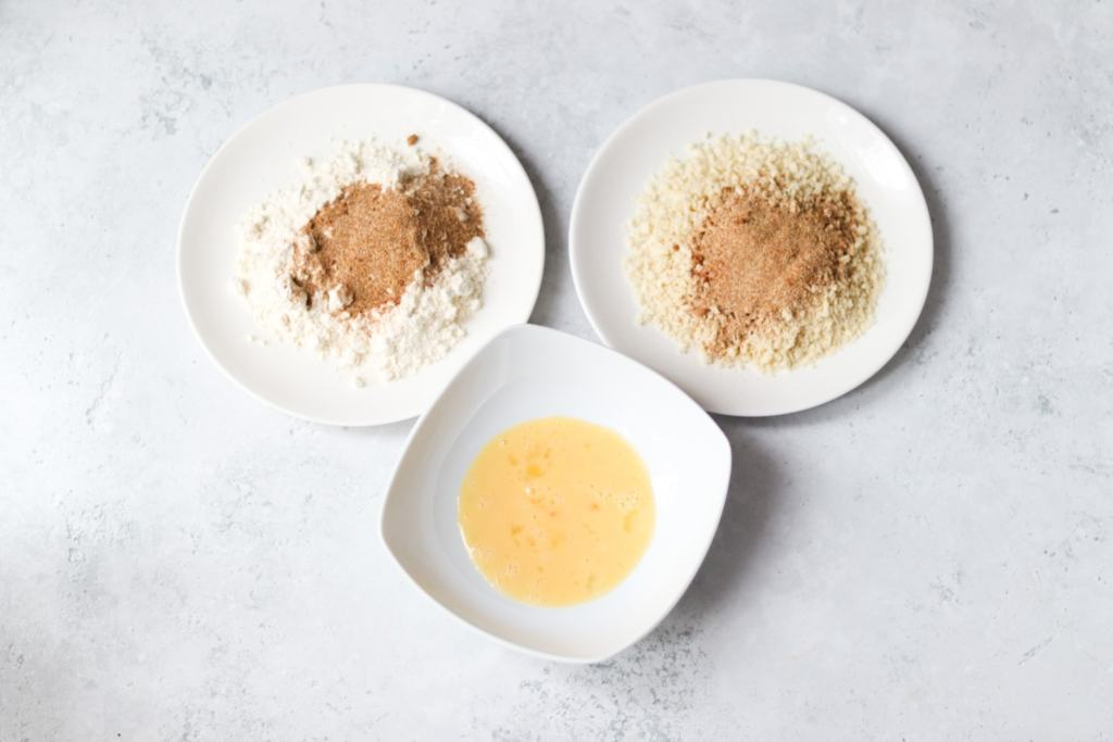Adding spice mix to flour and breadcrumbs