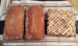 Crunchy topped lemon drizzle loaves and blackberry and orange cake with orange icing.