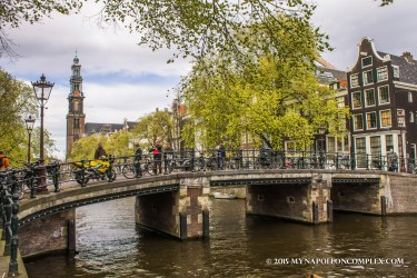Picture of Amsterdam canal with Westerkerk in the background.