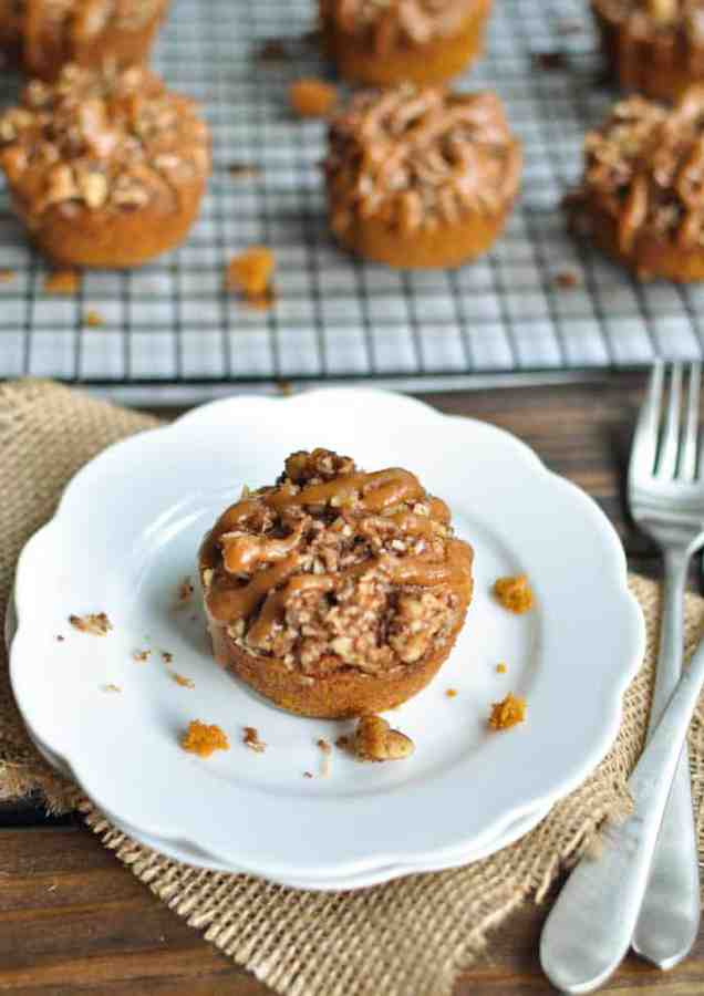 Almond butter muffins with pumpkin and coconut flour topped with a nut streusel and maple sauce
