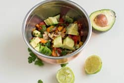 Add tomato, avocado, cilantro, and lime juice to the bowl