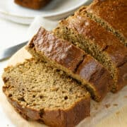 healthy banana bread with applesauce on a cutting board