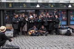 Singers in front of Cheers