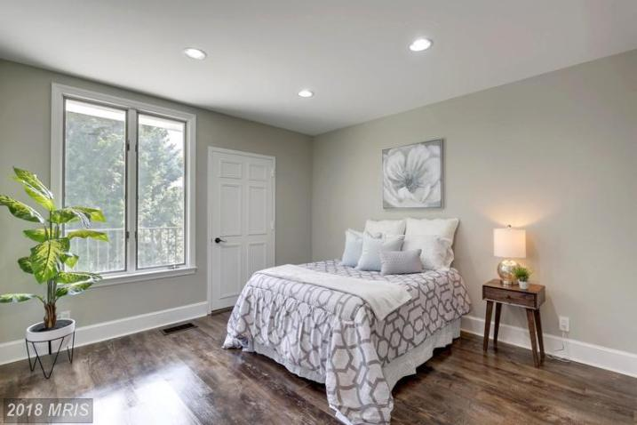 Picture of guest bedroom staged with gray and white