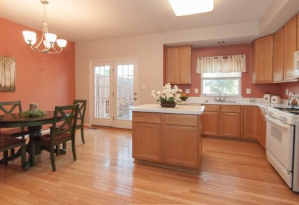Picture of home staging of a townhouse kitchen and dining area