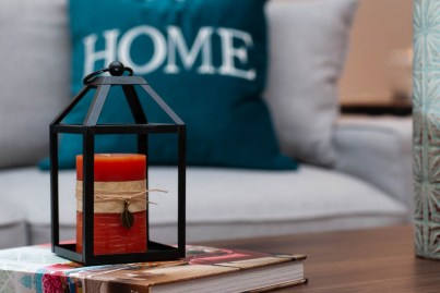 Picture of a lantern and candle used for home staging