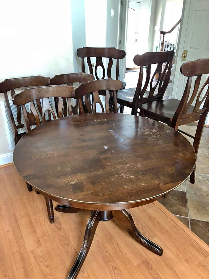 Picture of dark stained table and chair set before refinishing