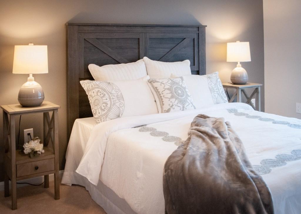 Farmhouse style master bedroom with wood headboard