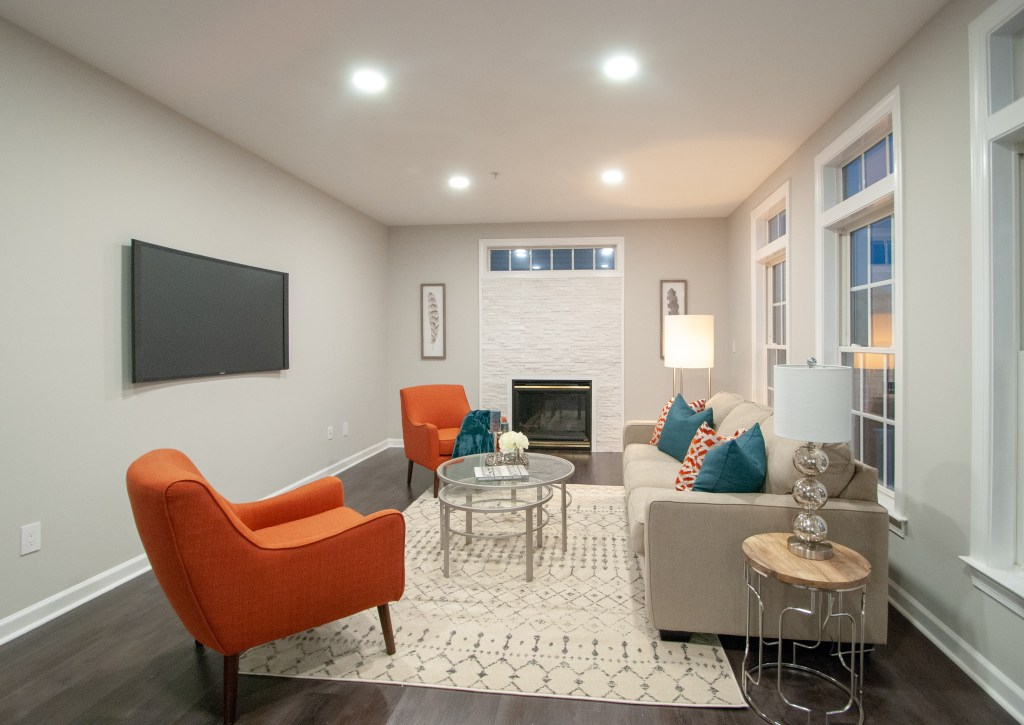 modern family room staging with orange and blue