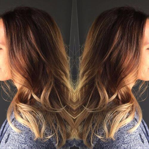 caramel hair color applied on dark brown hair