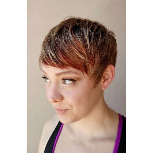pixie hairstyle with red, blonde and caramel highlights