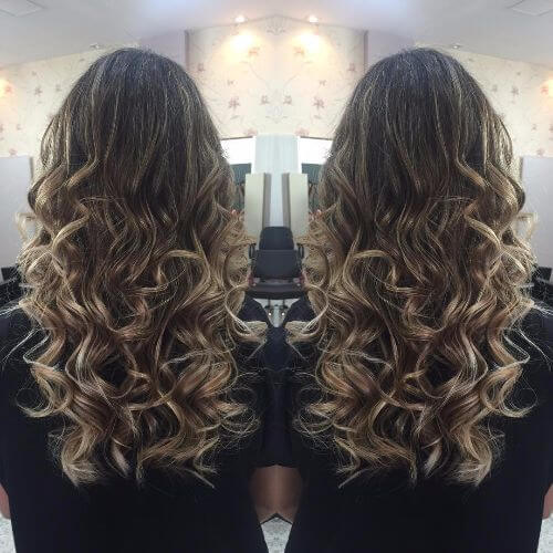 blonde highlights on long curly brown hair