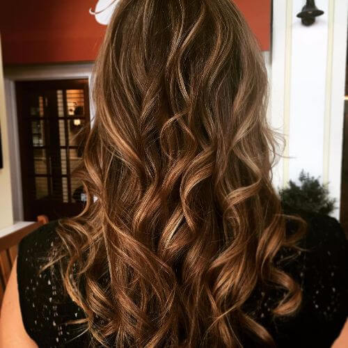 long wavy brown hair with caramel highlights