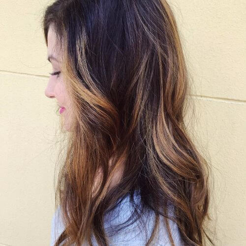 wavy brown hair with caramel highlights