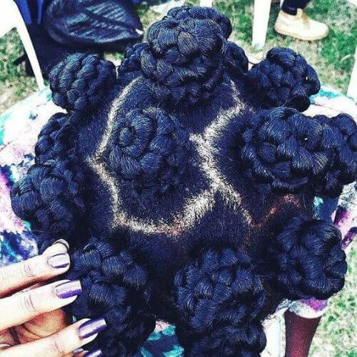Woman showing off her hairstyle bantu knots