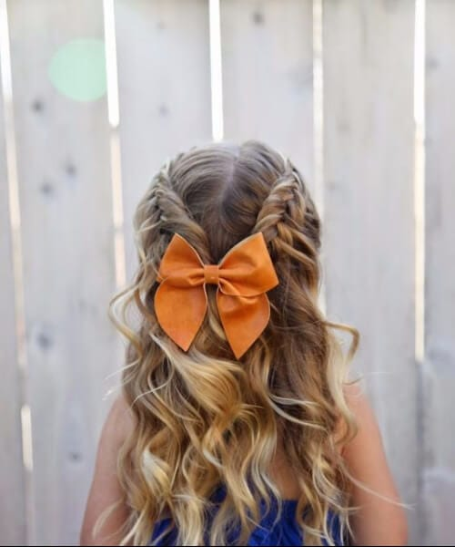 double french braid, bow, and waves little girl hairstyles
