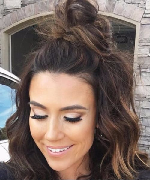 asymmetrical messy top knot medium length hairstyles.