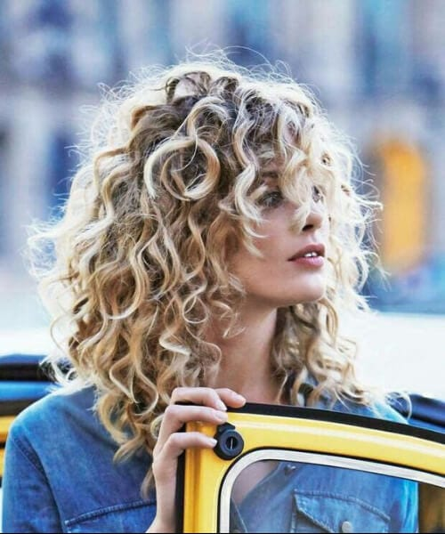 very curly medium length hairstyles