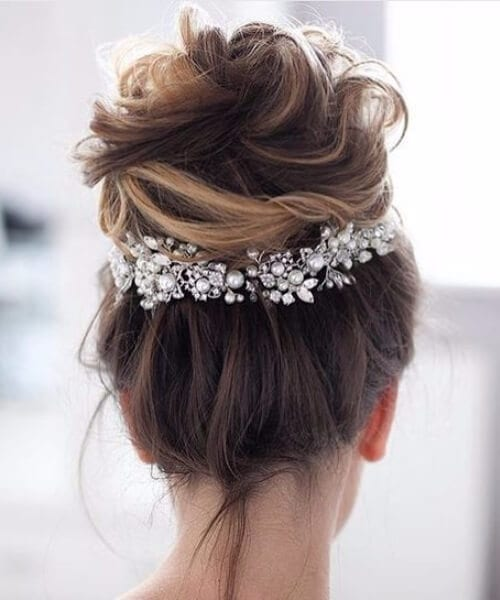 high textured messy bun with embellishments wedding hairstyles for long hair