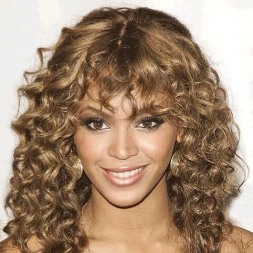beyonce curly hair with bangs