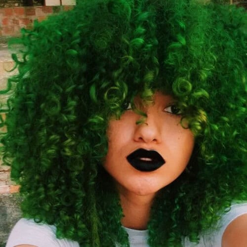 moss green curly hair with bangs