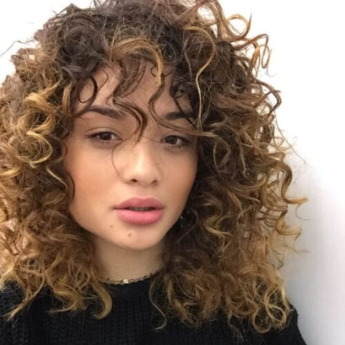 natural curly hair with bangs