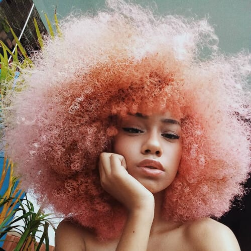 pink afro curly hair with bangs