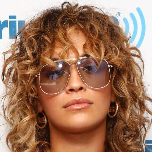 rita ora curly hair with bangs