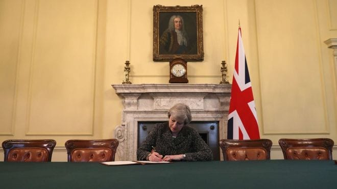 May signs letter that will trigger Brexit
