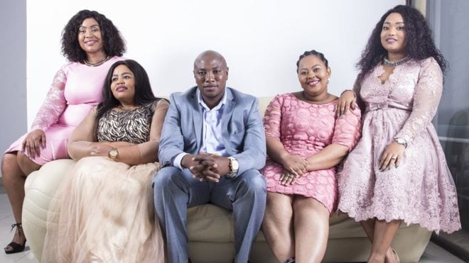 Man with four wives encourages men to follow in his footsteps