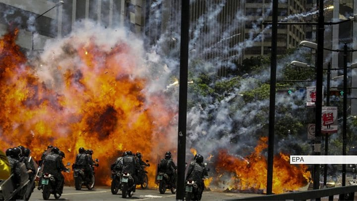 Venezuela searches for rebels after deadly clash at army base