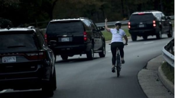 Woman fired for showing Trump motorcade the middle finger