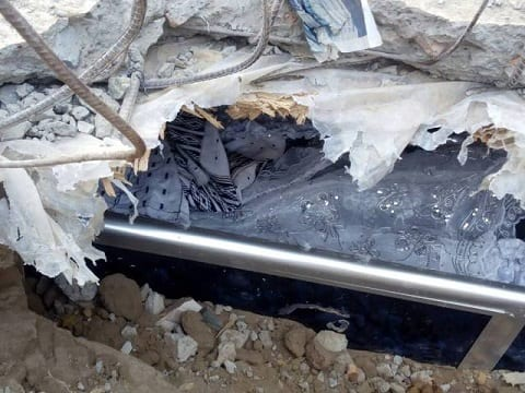 PHOTOS:'Undertaker' exhumes dead body over GH¢20 debt