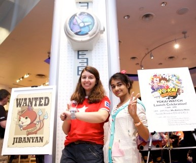 In this photo provided by Nintendo of America, fans pose with a larger-than-life replica of the Yo-Kai Watch at the launch celebration of the YO-KAI WATCH game for Nintendo 3DS at Nintendo World store on Nov. 7, 2015. Fans were treated to hands-on time with the game, appearances with costume character Jibanyan and a special autograph signing with Founder, President/CEO of LEVEL-5 Inc. Akihiro Hino.