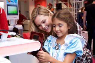 In this photo released by Nintendo of America, guests are treated to a special preview event of the Disney Magical World 2 video game for the Nintendo 3DS family of systems ahead of its release on Oct. 14. Hosted by Hollywood Records recording artist Olivia Holt, players explored Castleton, a world full of Disney characters.