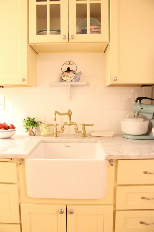 SUZANNE'S SWEET YELLOW KITCHEN. I LOVE LOVE LOVE LOVE THE FARM SINK! SUCH A PERFECT ADDITION TO HER COTTAGE KITCHEN!