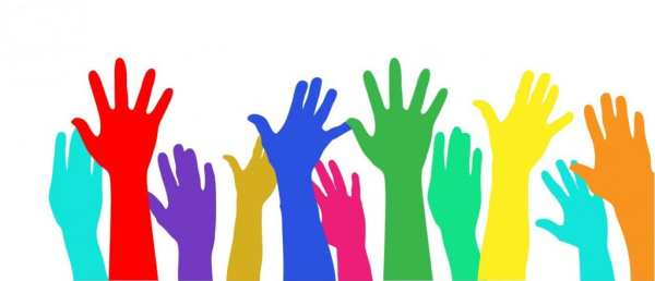 Colorful raised hands on white background