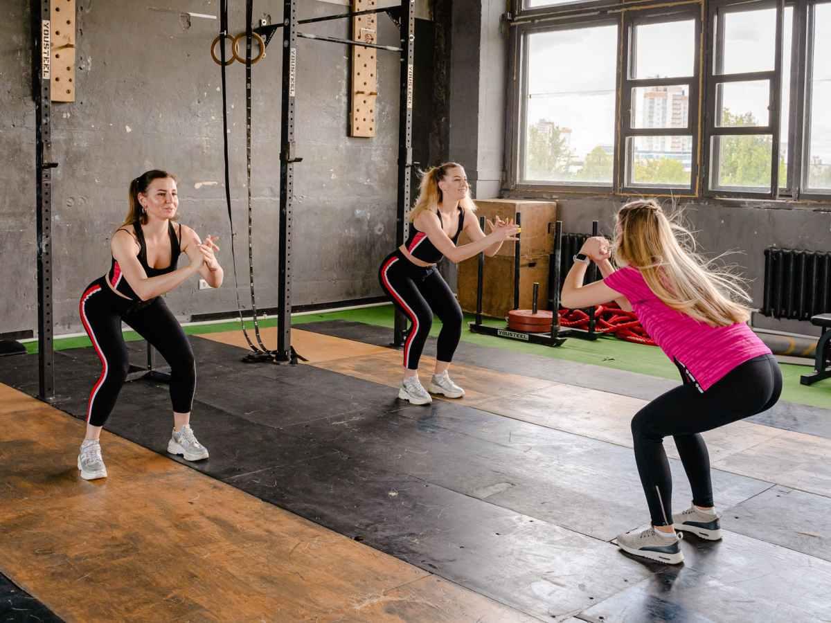 photo of women doing squats